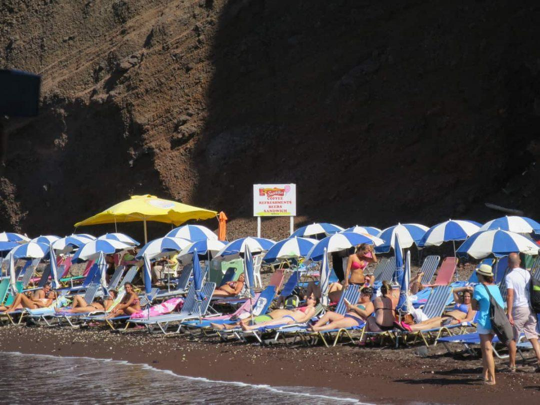 Sunbaking on Red Beach one of the best beaches on Santorini