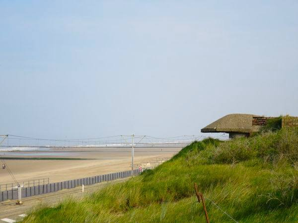 Atlantic Wall German bunker in the sand dunes facing the North Sea