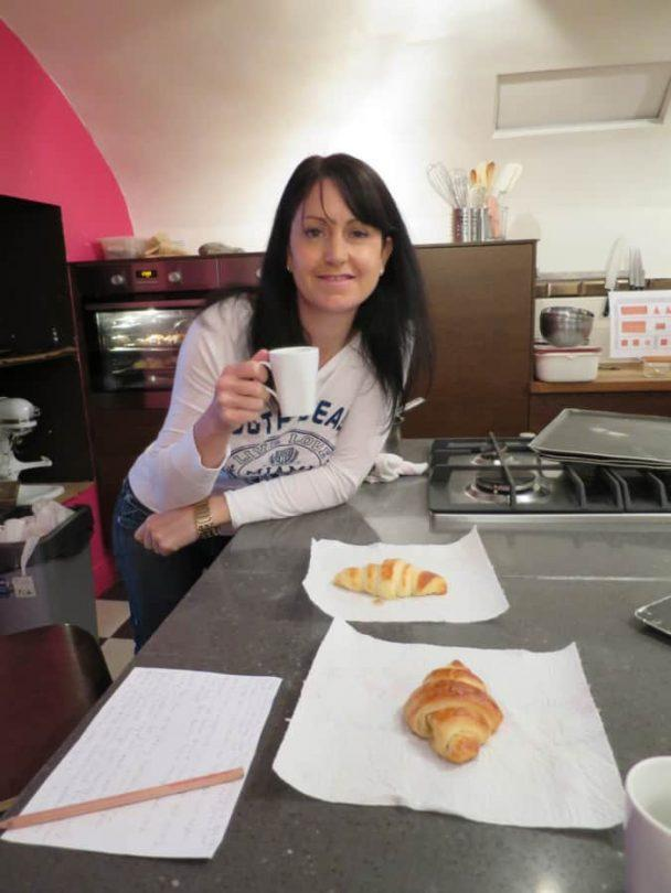 Eating croissants from my cooking class in Paris