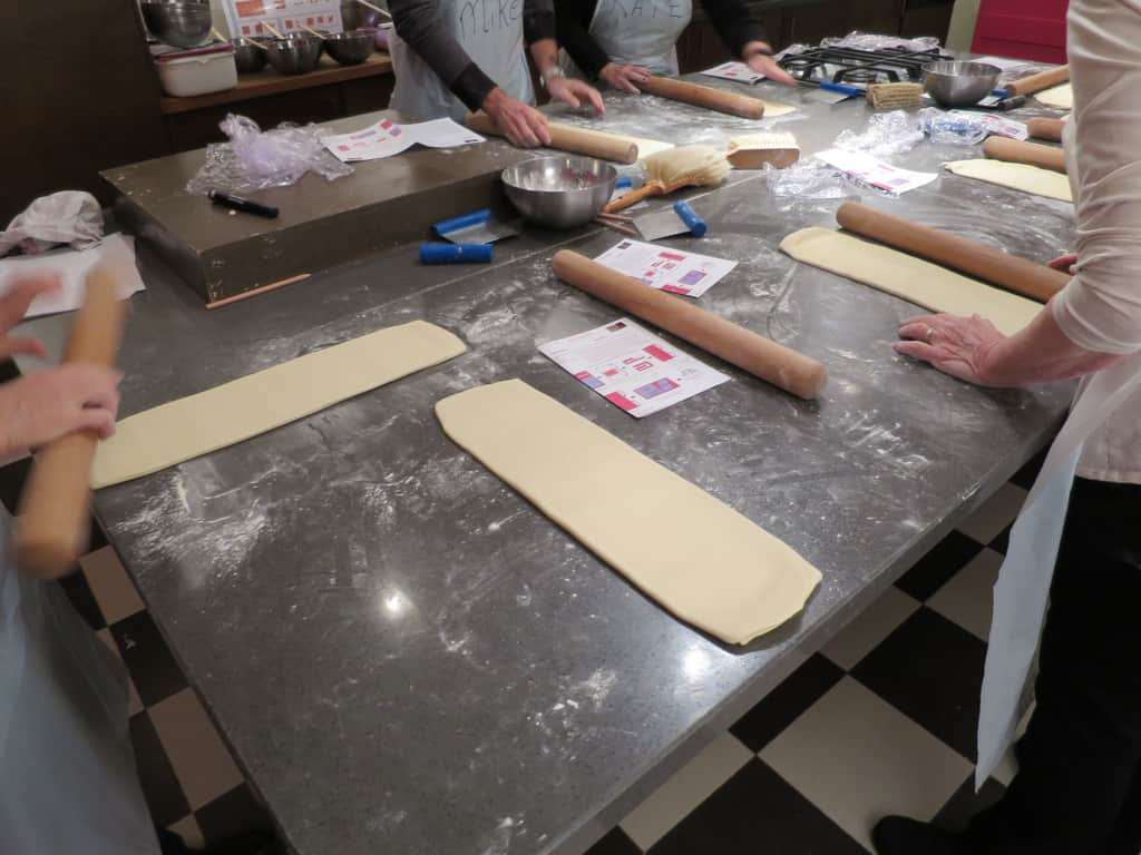 Rolling out dough for cooking class in Paris