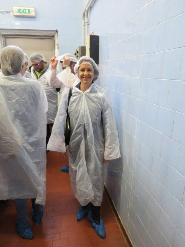Covering up before the parmigiano reggiano food tour in parma italy