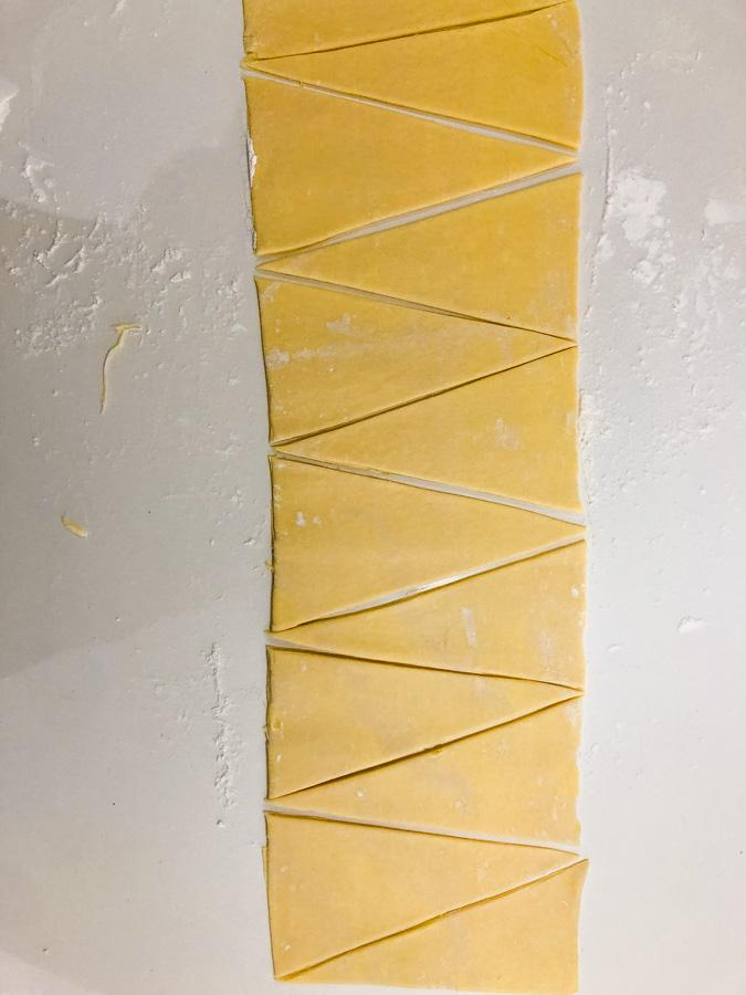 croissant dough cut into triangles