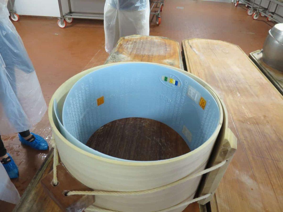 Making parmigiano reggiano on food tour of italy