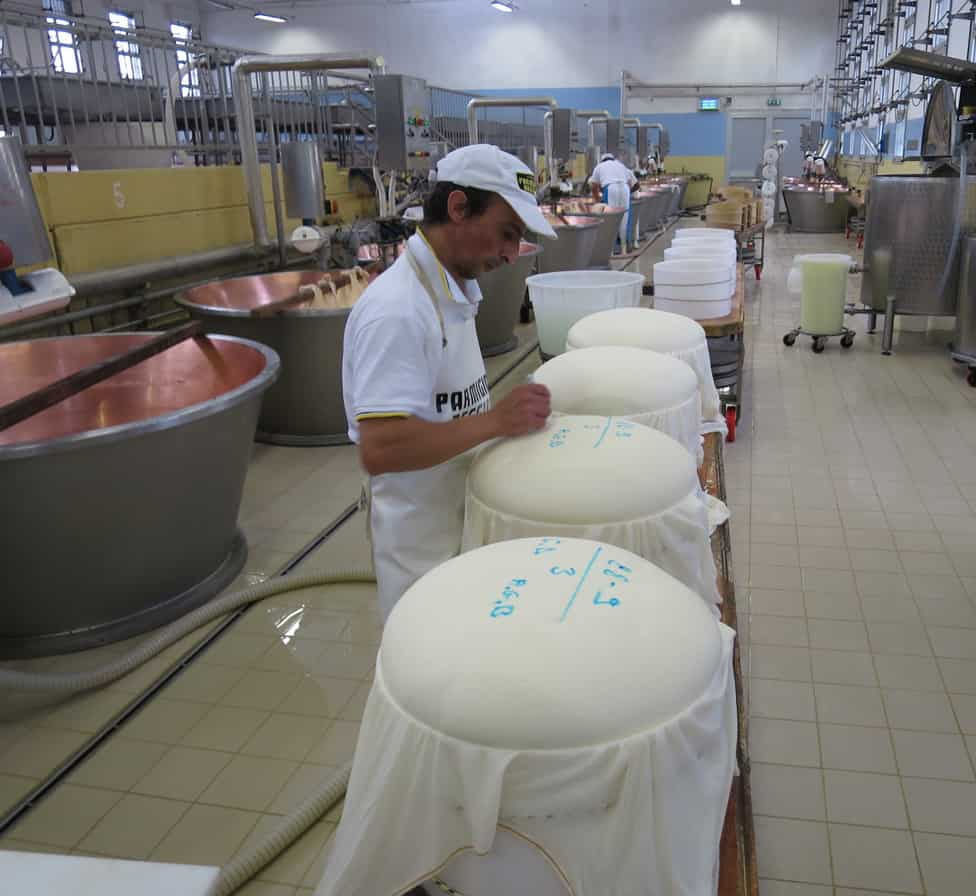 Making parmigiano reggiano food tour italy