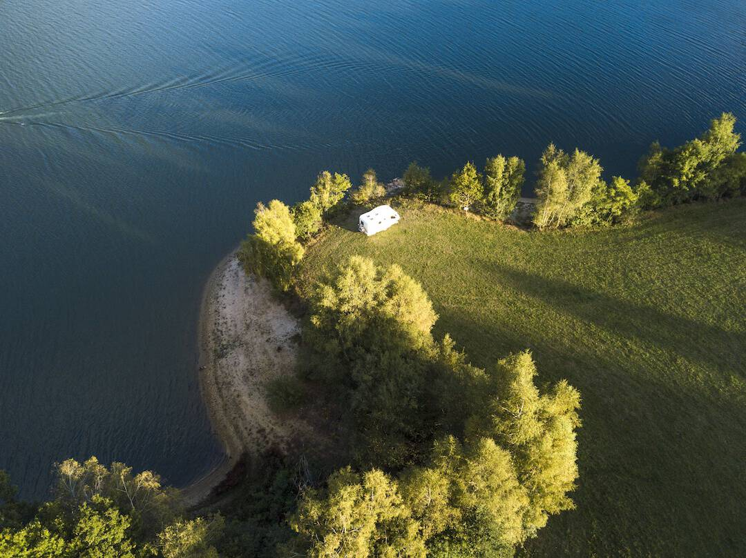 drone shot of motorhome near lake in France Europe