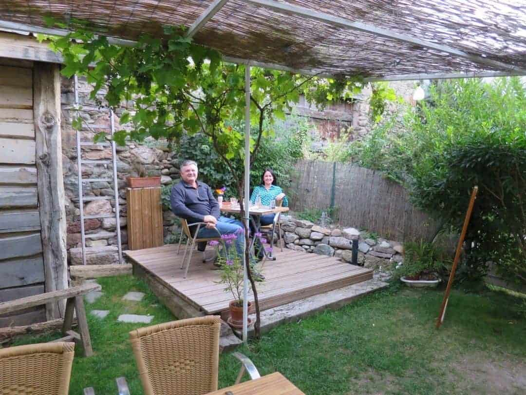 Sitting in the back garden Restaurant Le Galet