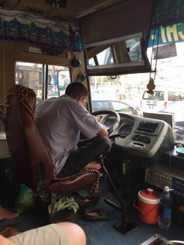 Bus driver eating pho - catching the bus to the cu chi tunnels