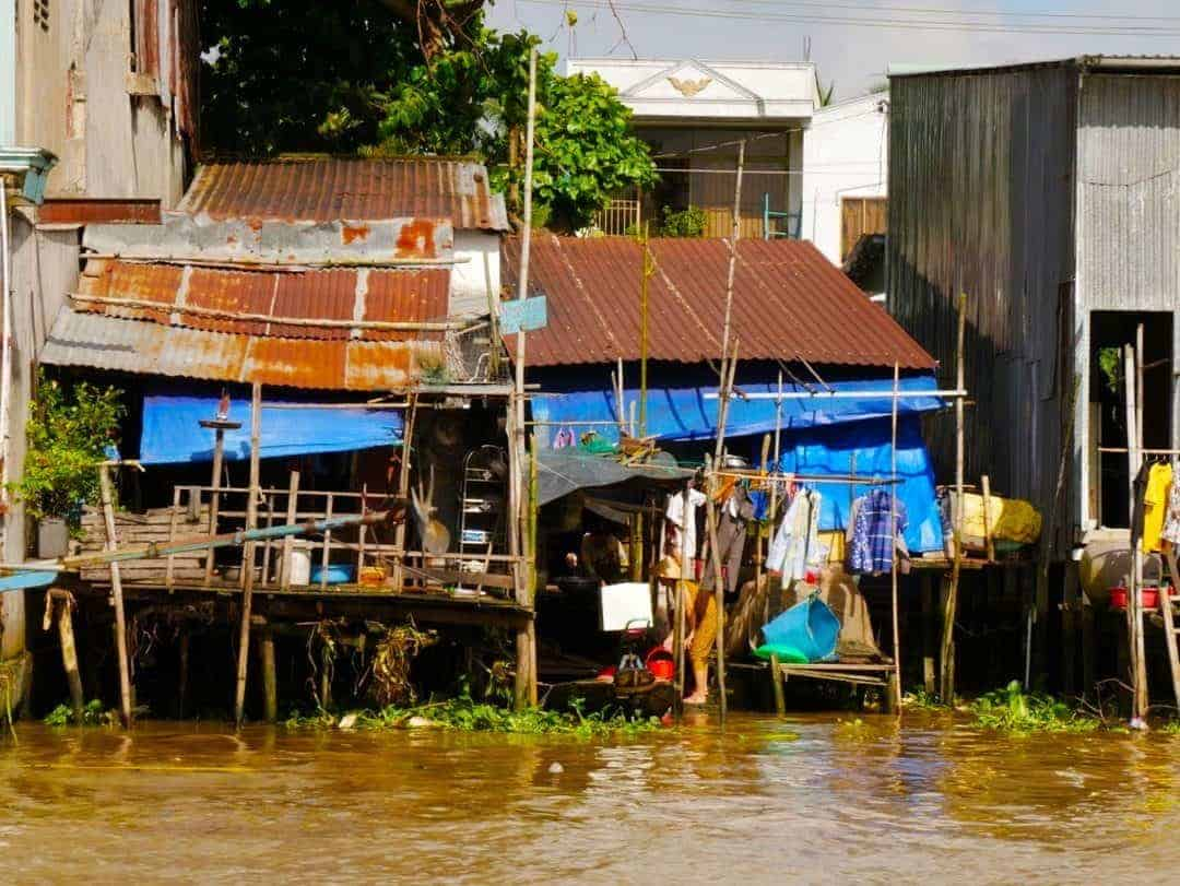 houses falling into disrepair on the mekong river