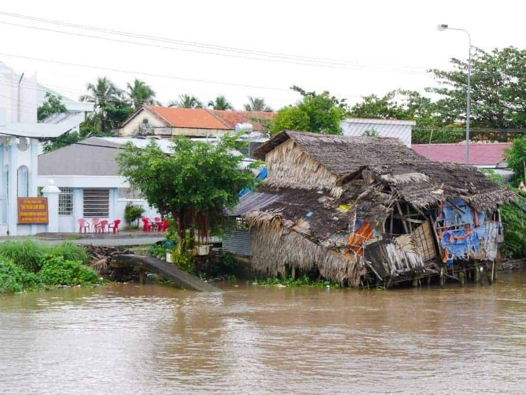 deteriorating house on the mekong river