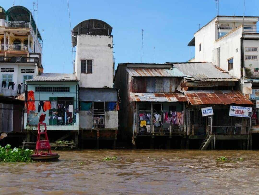 The houses that line the banks of the Mekong - best things to see in the mekong delta