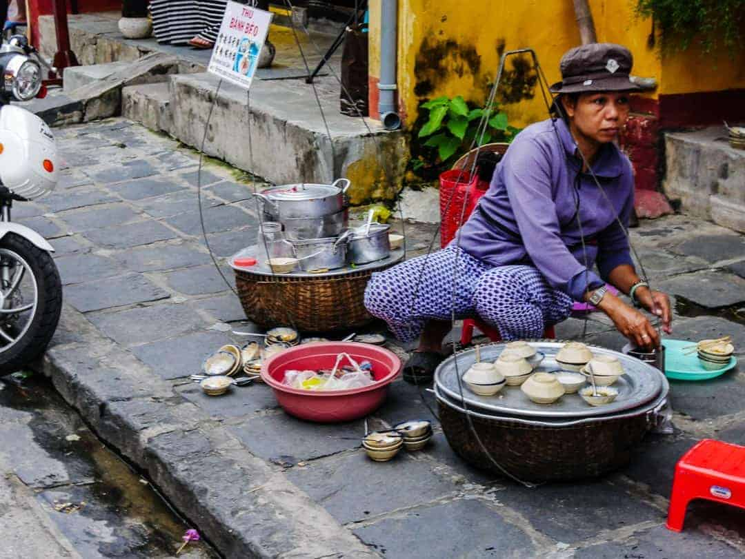 street vendor cooking on the footpath in Hoi An
