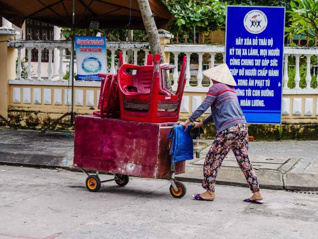 pushing carts in Hoi An