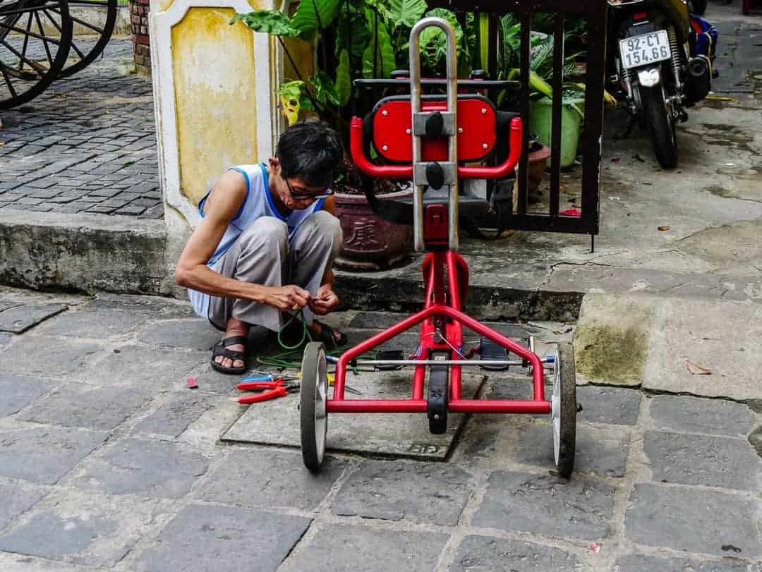man fixing trolly on street