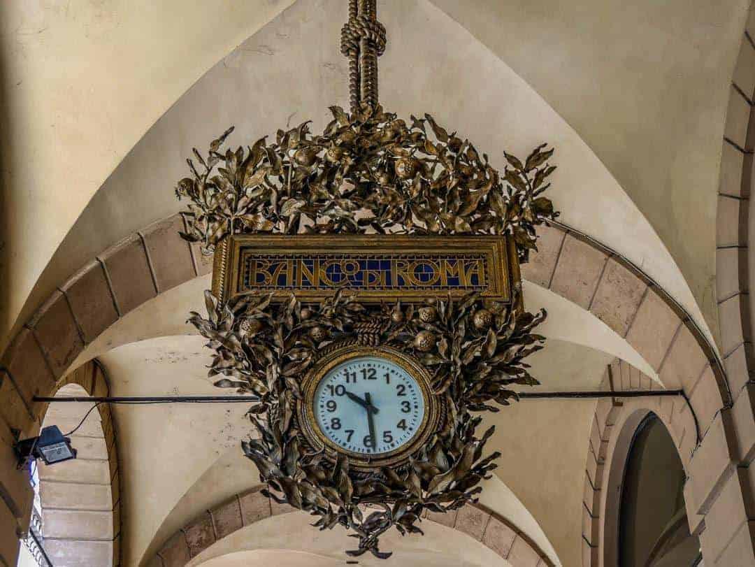 ornate clock under the portico