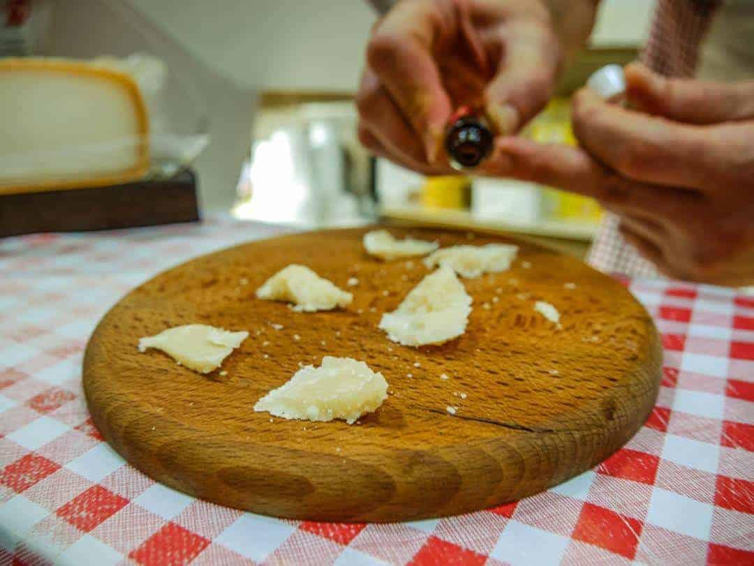 tasting parmigiano reggiano cheese in bologna