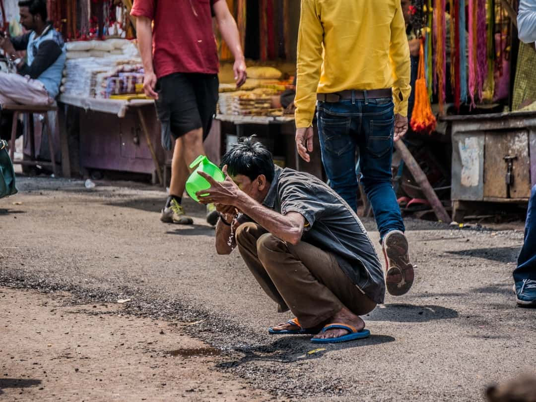 indian drinking in the street