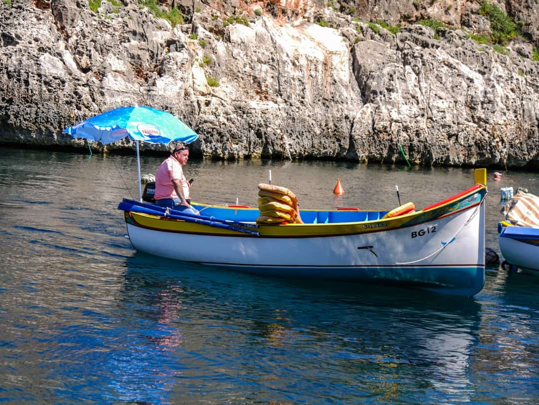 waiting for tourists at the blue Grotto