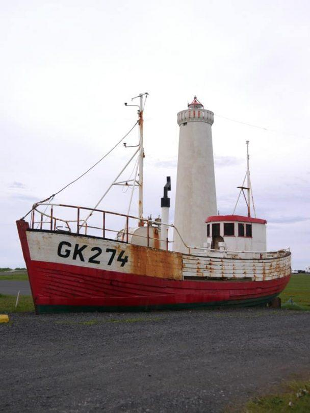 Garður lighthouse and boat