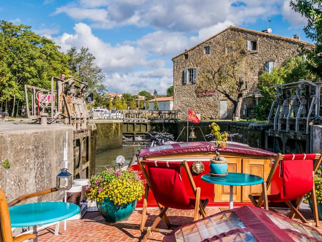 Savannah Barge Canal du Midi France passing towns - barge holidays in france