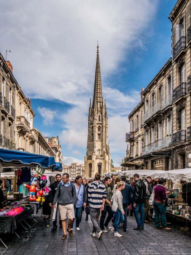 the spire of the st michel tower can be seen from the market