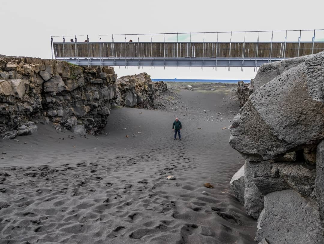 stiring standing under the bridge that straddles the tectonic plates - Midllina Iceland