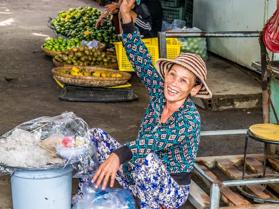 lady at market smiling