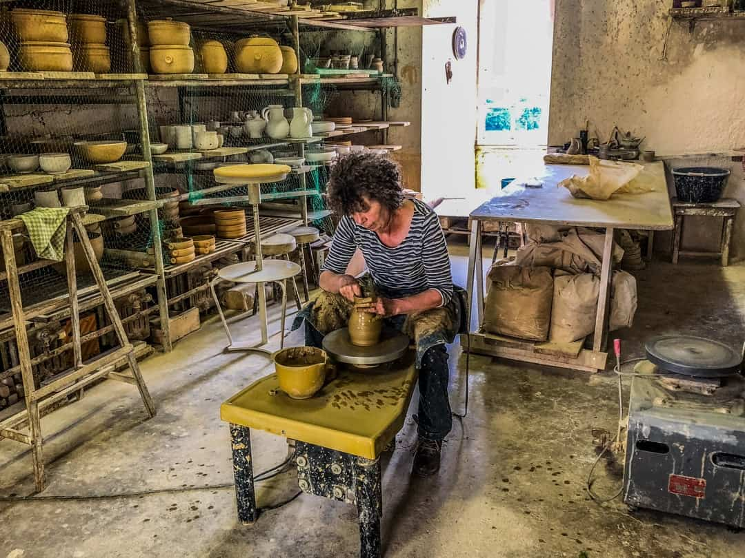 family owner making pottery at chateau de ratilly