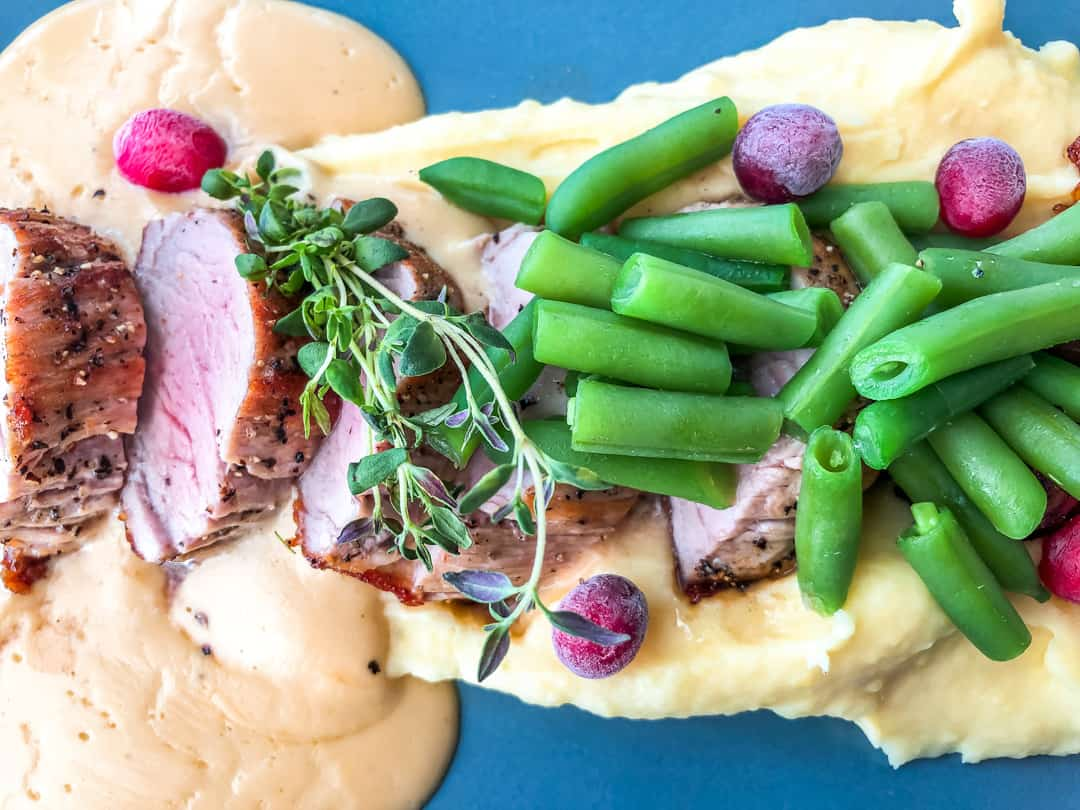 pork tenderloin with potato puree mushrroms and green beans and a honey mustard sauce