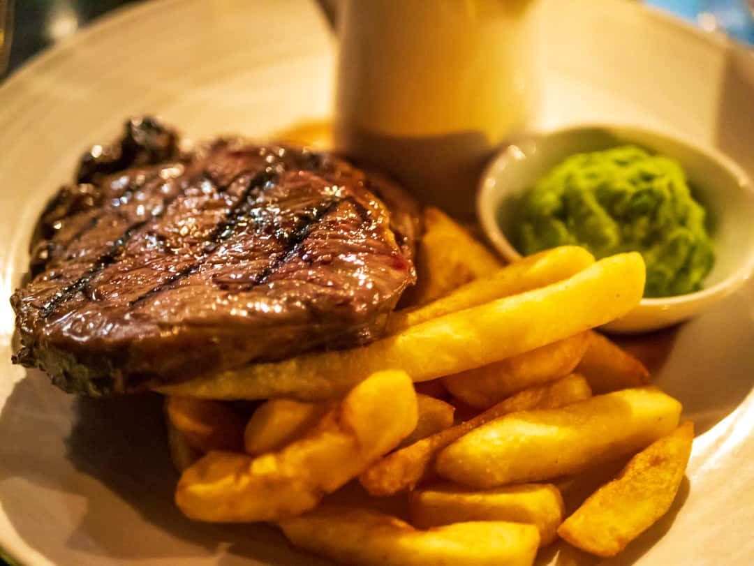 250g grass-fed rib eye steak served with mushy peas, steak fries and Dianne sauce