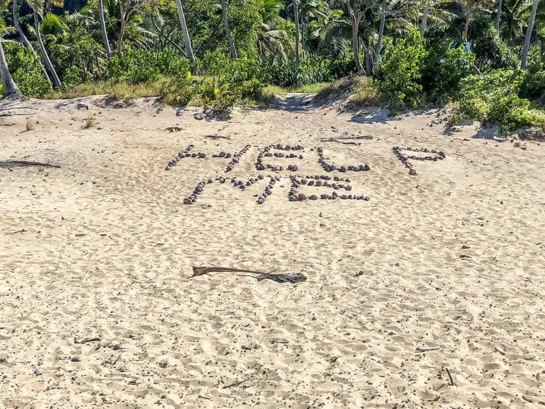 Where Tom Hanks wrote his Help Me message on the beach at Mondriki Fiji family holidays