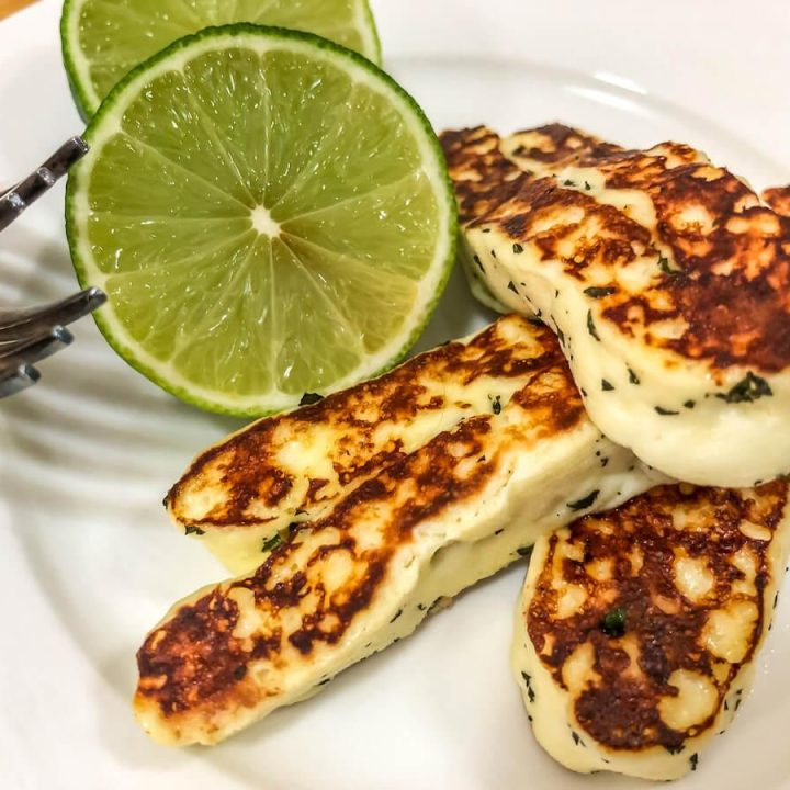 cooked halloumi cheese with lime wedges