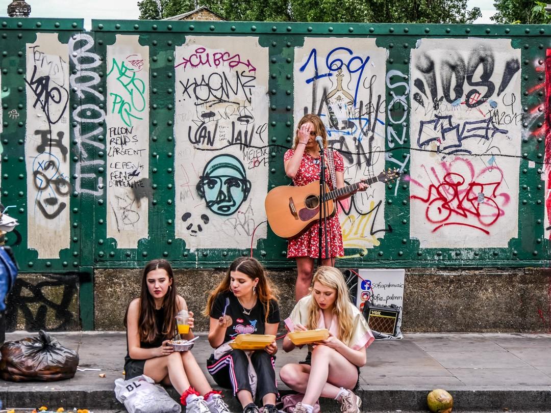 girls eating food in street