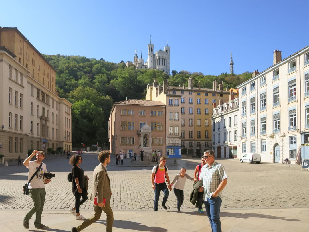 st jean place with basilica on hill